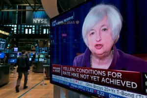 The press conference of Federal Reserve Chairperson Janet Yellen appears on a television screen on the floor of the New York Stock Exchange, Wednesday, June 17, 2015. The U.S. economy has strengthened since a slump early this year, the Federal Reserve said Wednesday, but it wants to see further gains in the job market and higher inflation before raising interest rates from record lows.  (AP Photo/Richard Drew)